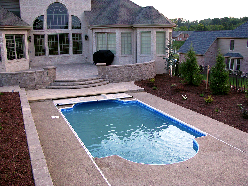 Pools outdoor covers unique shape roman pool toptrack for Garden pool covers